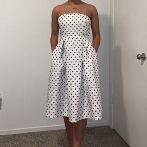 Polkadot sleeve less midi dress